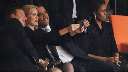 David Cameron, Helle Thorning-Schmidt and Barack Obama taking a selfie at Nelson Mandela's memorial service in Johannesburg, 10 December 2013.